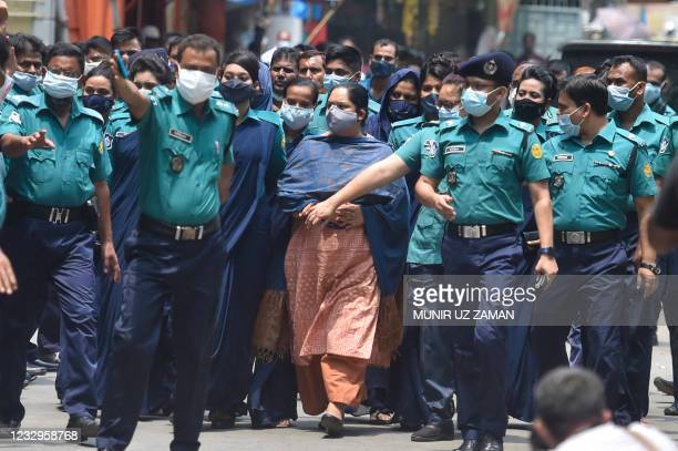 Police escort investigative journalist Rozina Islam to a court in Dhaka on May 18 a day after being arrested on accusation of stealing documents and...