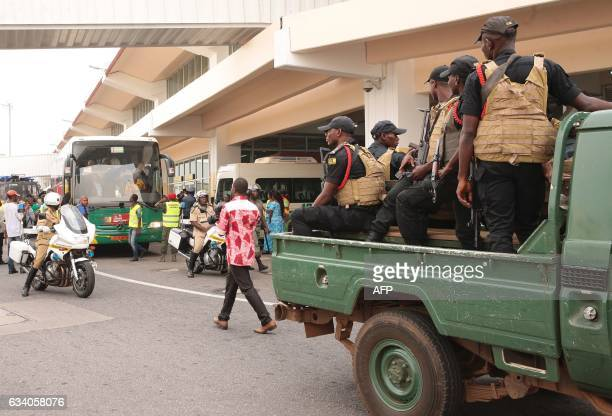 A police escort is in place as the Cameroon national football team leaves the international airport for the capital Yaounde on February 6 a day after...