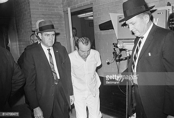 Police escort Jack Ruby killer of accused presidential assassin Lee Harvey Oswald from the Dallas city jail to a county facility It was during just...