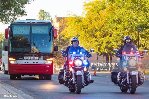 Police escort leads the Texas Tech Red Raiders team buses before the college football game against the Iowa State Cyclones on October 19, 2019 at...