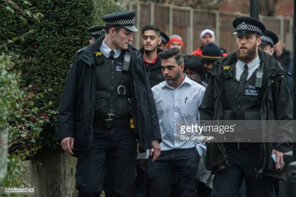 Police escort local people out of the area after a man was shot and killed by armed police on February 2 2020 in London England The Metropolitan...