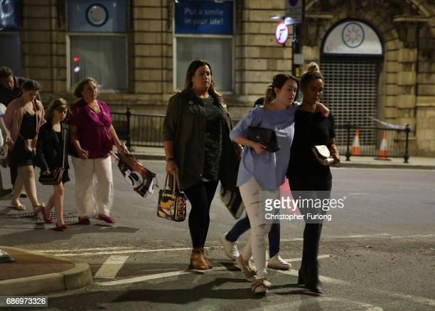 Police escort members of the public from the Manchester Arena on May 23 2017 in Manchester England An explosion occurred at Manchester Arena as...