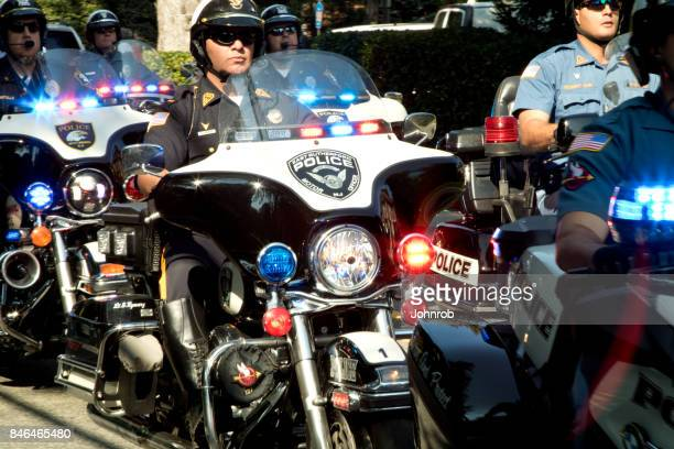 Police escort on motorcycles at annual benefit rally