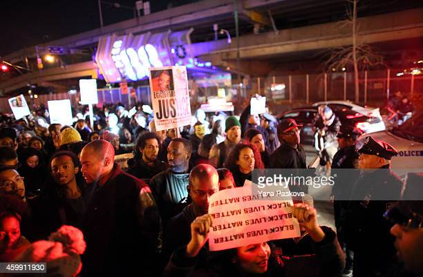 Police escort protesters off the West Side Highway December 3 2014 in New York Protests began after a Grand Jury decided to not indict officer Daniel...