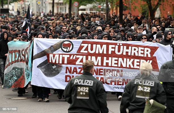 Police escort several hundred mostly leftwing demonstrators protesting against a local pub popular with neoNazis called Zum Henker in Schoeneweide...
