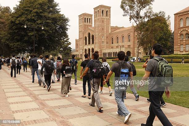 LOS ANGELES CA JUNE 01 2016 Police escort students after they determined there was no more threat on the UCLA campus as two people were killed in a...