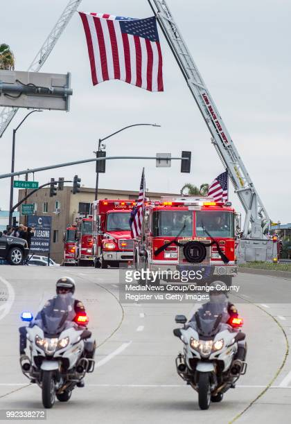Police escort the Long Beach Fire engine carrying the casket of Long Beach Fire Captain David Rosa who was killed in the line of duty along Shoreline...