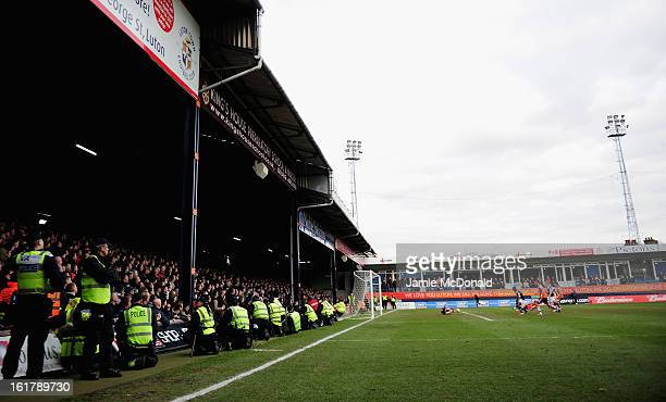Police escort the Millwall fans to the station during the FA Cup with Budweiser firth round match between Luton Town and Millwall at Kenilworth Road...