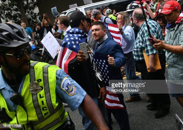 TOPSHOT Police escort 'Unite the Right' organizer Jason Kessler and protestors during a farright rally at Lafayette Park opposite the White House...