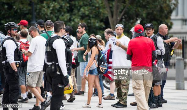 Police escort Unite the Right protesters onto Pennsylvania Ave by the White House for their rally in Lafayette Square on the anniversary of the...