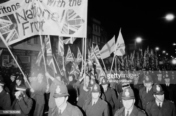 Police escorting demonstrators during a National Front protest UK 25th March 1975