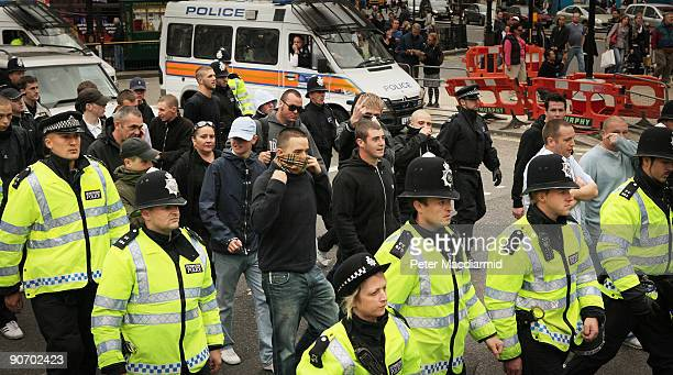 Police escourt right wing English Defence League demonstrators away from a Muslim demonstration in Picadilly on September 13 2009 in London England...