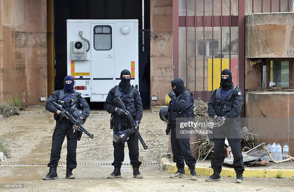 ERIS police evacuate Draguignan jail in the aftermath of flooding in a western district of the French south eastern city of Draguignan (Var) on June 16, 2010. At least eleven people have been killed by flash floods in Draguignan and in the neighboring city of Luc, caused by heavy rains.
