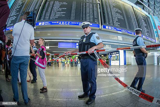 Police evacuate passengers due to a bomb alert at Frankfurt International Airport on August 31 2016 in Frankfurt am Main Germany Frankfurt airport...