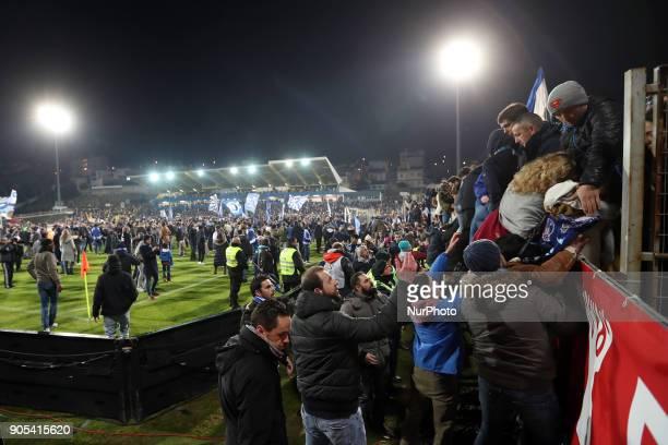 Police evacuate the Porto's supporters from a stand during the Portuguese League football match Estoril Praia vs FC Porto at the Antonio Coimbra da...