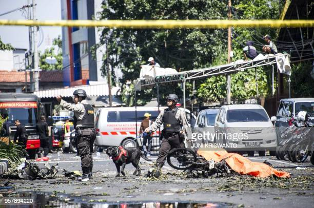 K9 police examine a site following attacks outside the Surabaya Centre Pentecostal Church in Surabaya East Java on May 13 2018 A series of blasts...