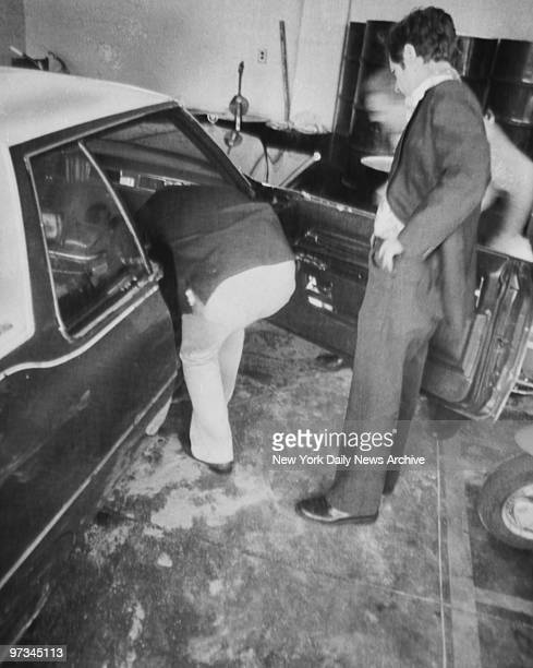 Police examine car in which Judith Placido was shot by David Berkowitz