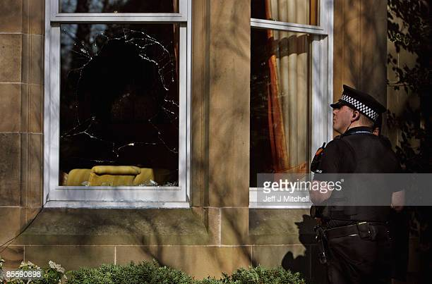 Police examine the damage to the Edinburgh home of former Royal Bank of Scotland boss Sir Fred Goodwin on March 25 2009 in Edinburgh Scotland Windows...