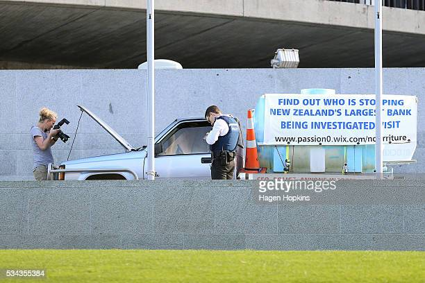 Police examine the vehicle at the centre of an incident at Parliament on May 26 2016 in Wellington New Zealand Police have blocked off the...