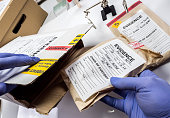 Police expert saved in a box records and evidence of a case of murder in the laboratory scientist