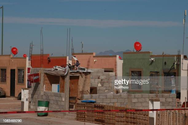 Police experts outside the house where a complete family was murdered in Ciudad Juarez Chihuahua Killed entire family of 5 with a knife inside a...