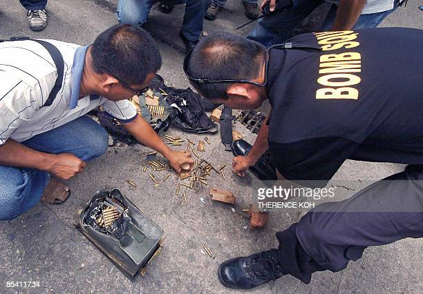 Police explosive ordnance experts inspect a boxfull of ammunition after suspicious baggage that was left inside a mall was discovered by bomb squad...