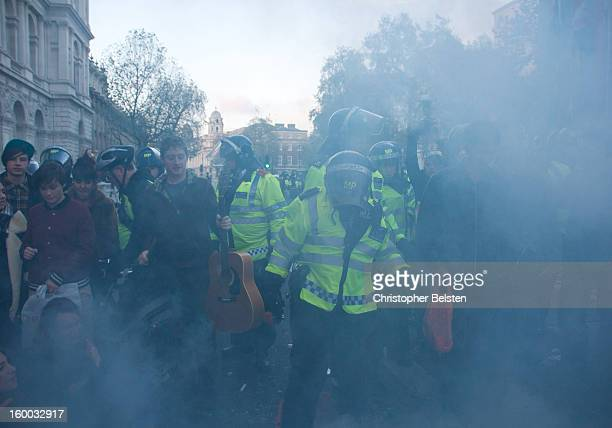 CONTENT] Police extinguish fire and break up student protest on Whitehall Londonm during the G20 Demonstrations November 2010