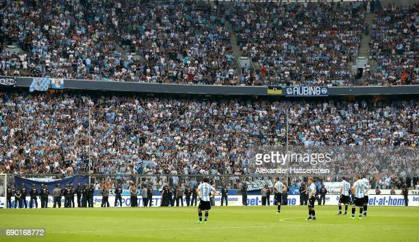 Police face 1860 Muenchen fans during the Second Bundesliga Playoff second leg match betweenTSV 1860 Muenchen and Jahn Regensburg at Allianz Arena on...