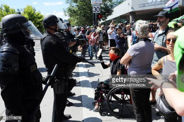 Police face altright activists and antifascist protestors gathered as rightwing rally organizer Patriot Prayer founder and Republican Senate...