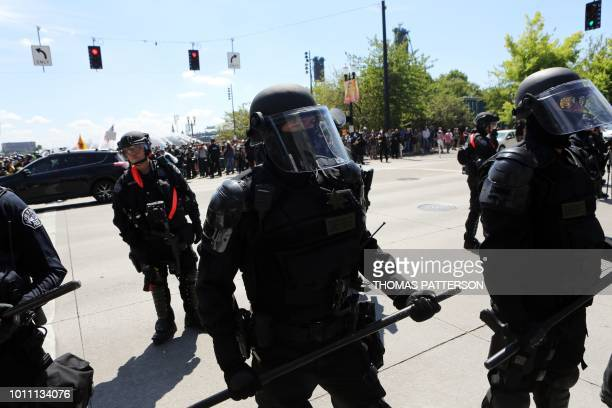 Police face antifascist protestors gathered as rightwing rally organizer Patriot Prayer founder and Republican Senate candidate Joey Gibson speaks...
