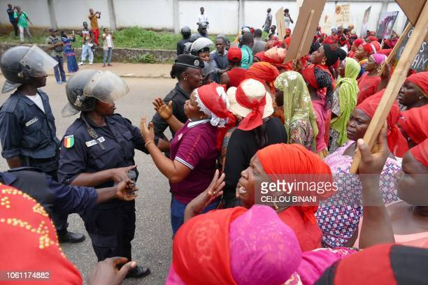 Police face women Guinean opposition supporters during a demonstration against a series of bloody crackdowns on opposition demonstrations on November...