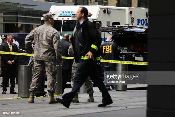 Police FBI and other emergency workers gather outside the Time Warner Center after an explosive device was found this morning on October 24 2018 in...