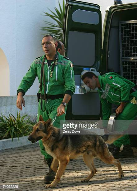 Police feed sniffer dogs at the Ocean Club hotel where English girl Madeleine McCann aged three went missing on May 7 2007 in Praia da Luz Portugal...