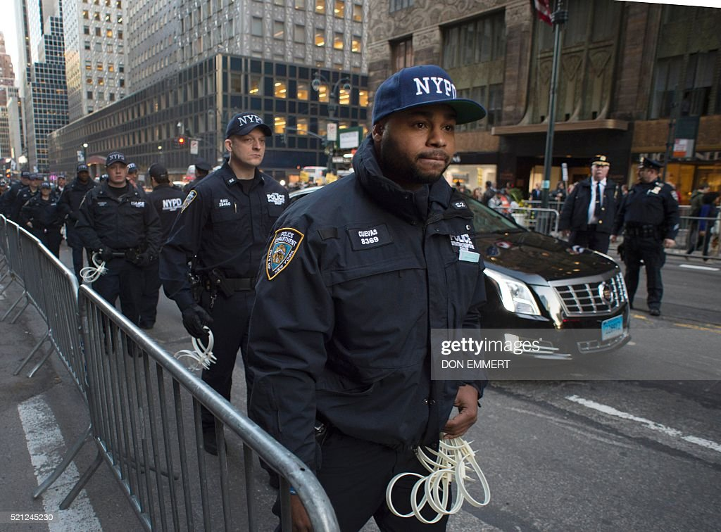 Police file into the area in preparation for arrests as demonstrators gather near Grand Central Station to protest against US Republican presidential candidate Donald Trump who was attending a New York GOP Gala April 14, 2014 in New York. / AFP / DON