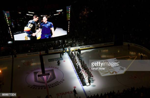 Police fire and medical personnel take the ice with members of the Vegas Golden Knights before their inaugural regularseason home opener against the...