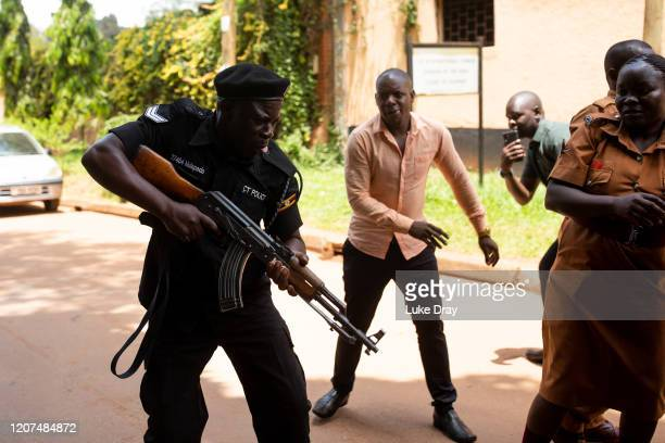 Police fire live rounds both into the air and towards journalists and supporters on February 20, 2020 in Kampala, Uganda. After spending more than a...