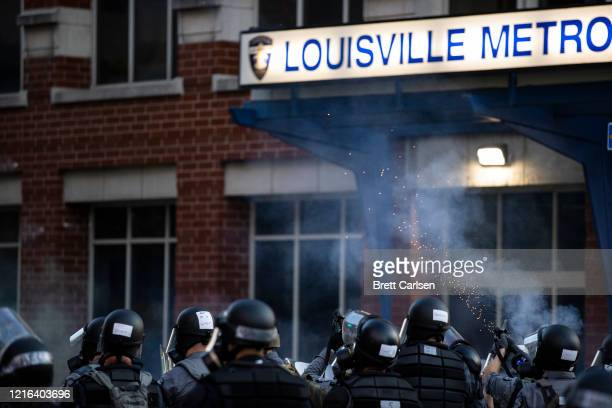 Police fire non-lethal devices towards a crowd of protesters on May 30, 2020 in Louisville, Kentucky. Protests have erupted after recent...