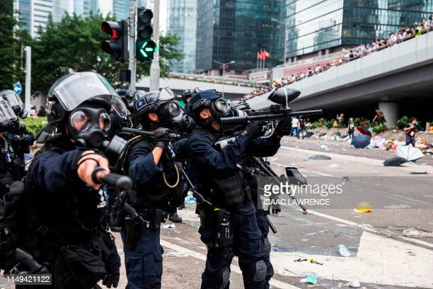 TOPSHOT Police fire nonlethal projectiles during violent clashes against protesters in Hong Kong on June 12 2019 Violent clashes broke out in Hong...