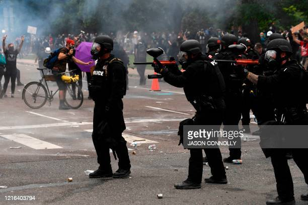 Police fire pepper spray and pepper balls toward protesters during a demonstration in Denver Colorado on May 30 over the death of George Floyd an...