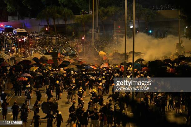 Police fire tear gas at protesters near the government headquarters in Hong Kong on July 2 on the 22nd anniversary of the city's handover from...
