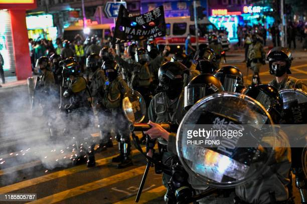 Police fire tear gas during a protest at Hung Hom area in Hong Kong on December 1 2019 Police fired tear gas and pepper spray in Hong Kong on...