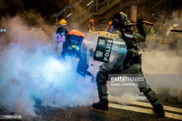 TOPSHOT Police fire tear gas during a protest in the district of Causeway Bay in Hong Kong on August 4 2019 Riot police fired tear gas on August 4 at...
