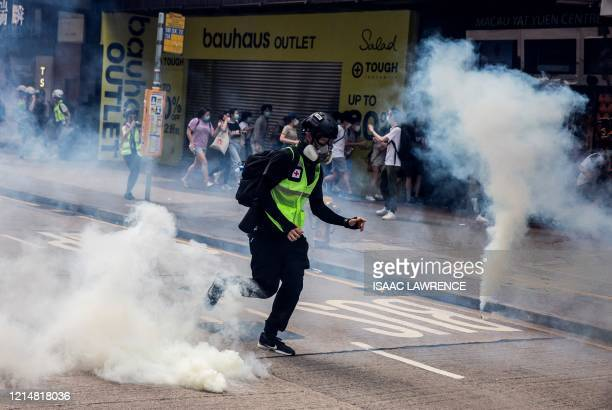 Police fire tear gas on protesters during a planned protests against a proposal to enact a new security legislation in Hong Kong on May 24, 2020. -...