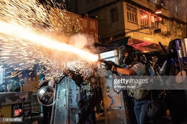 Police fire tear gas to clear pro-Democracy protesters during a demonstration on Hungry Ghost Festival day in the Sham Shui Po district on August 14,...