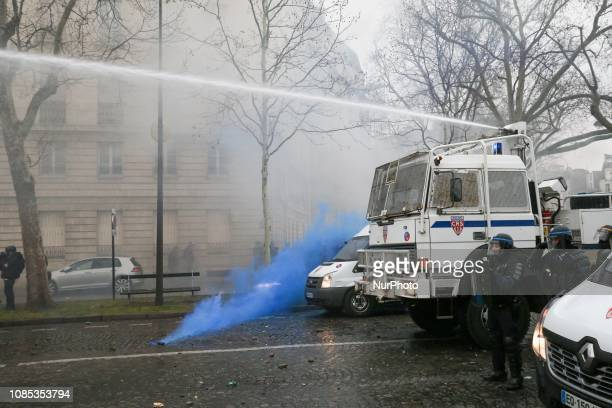 Police fired tear gas and water cannon in front of the Hotel national voice over Invalides in Paris on January 19 2019 during a demonstration called...