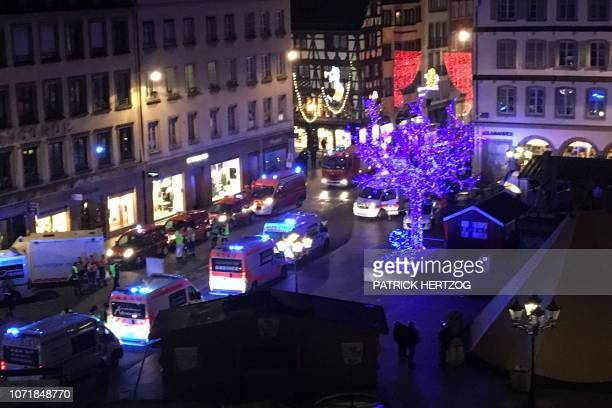 Police firefighters and emergency services intervene on Place Gutenberg after a shooting on December 11 2018 in Strasbourg eastern France At least...