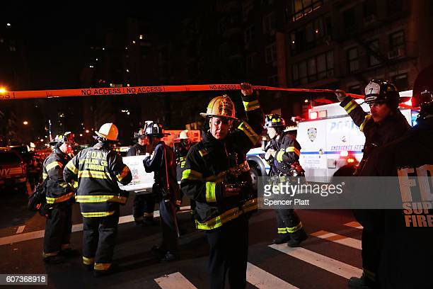 Police firefighters and emergency workers gather at the scene of an explosion in Manhattan on September 17 2016 in New York City The evening...