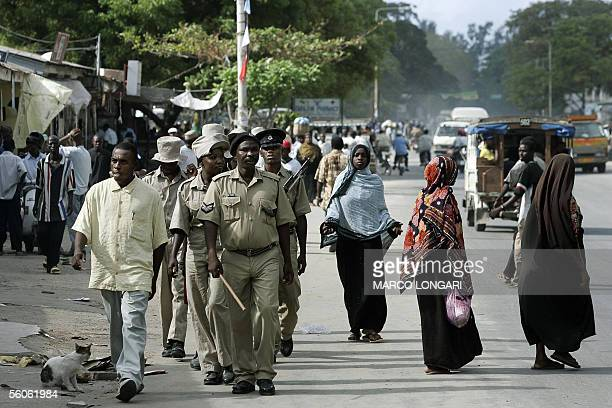 A police foot patrol strolls 03 November 2005 trough the Darajani market in Stone Town Zanzibar Amani Abeid Karume was sworn in as president of...