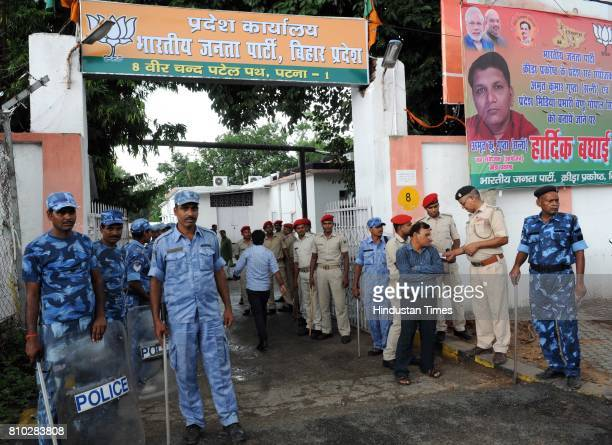 Police force deployed at the BJP office as CBI raids at former Railway Minister Lalu Prasad Yadav's residence on July 7 2017 in Patna India The CBI...