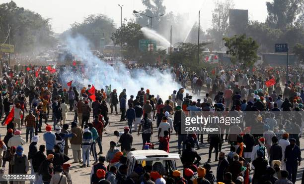 Police force firing tear gas to disperse protesters during the demonstration. Groups of farmers marched from Singhu border Delhi-Haryana border...